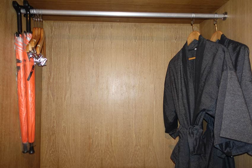Closet with robes and umbrellas at Page 10 hotel