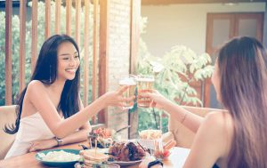 Thai women drinking beer and smiling