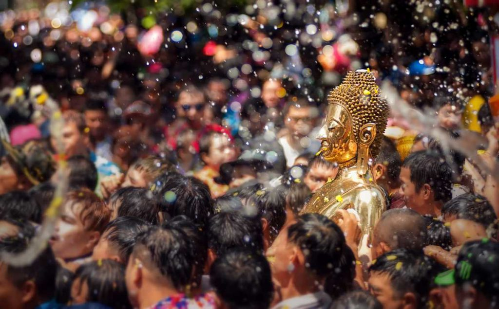 Buddha statue being carried during Songkran Water Festival Thailand