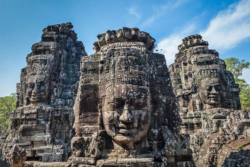 Faces carved into the Bayon Temple in Angkor Archaeological park, Siem Reap Cambodia